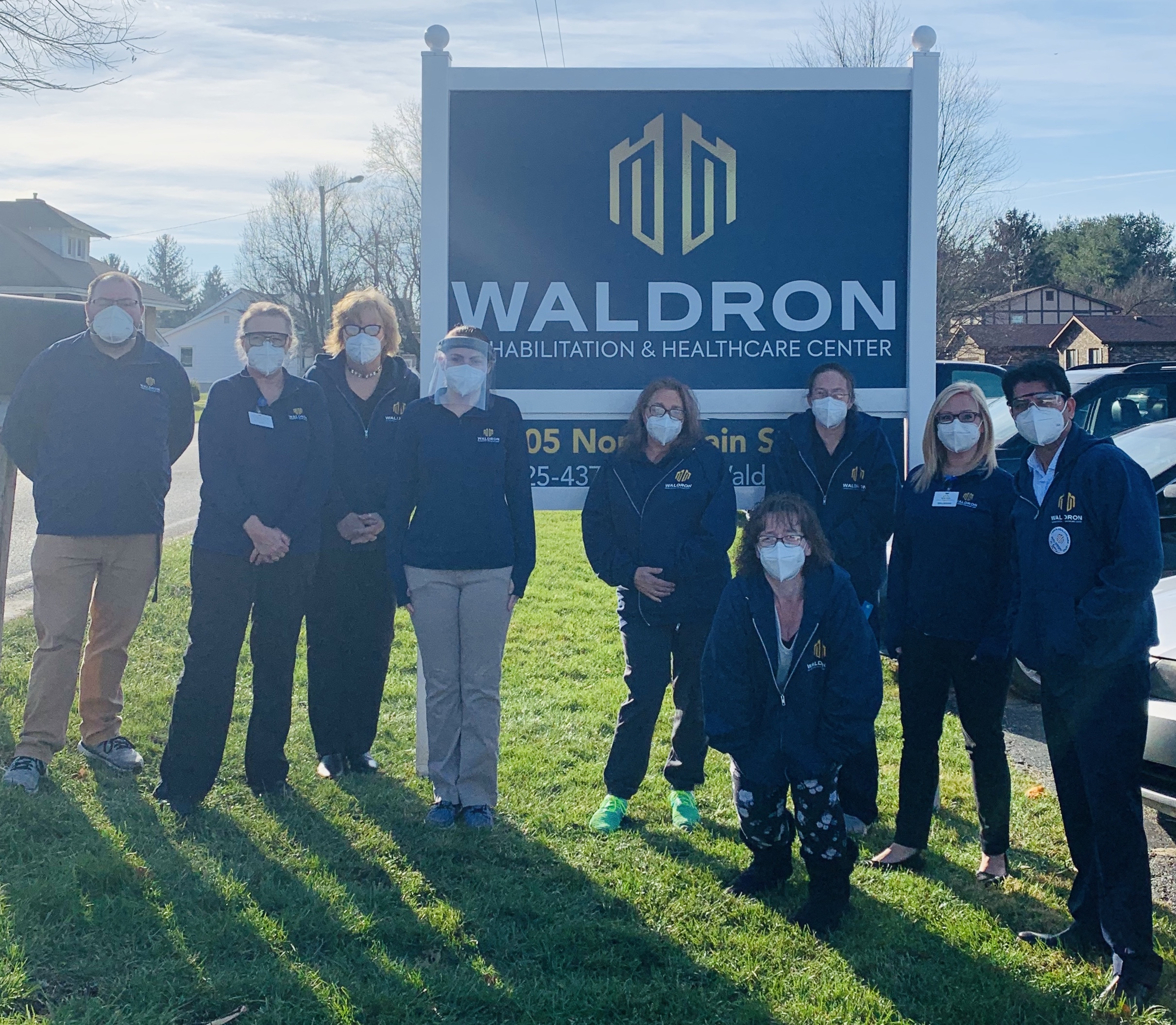 Waldron Staff By New Sign